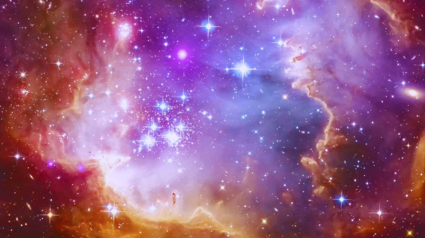 picture of a nebula in space, pink and purple